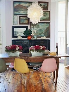Love the mismatched chairs #dining #chandelier