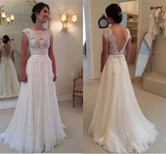 This small cap sleeve wedding gown has a lace embellished bodice. There is a thin satin belt feature. The skirt flows in a light weight fabric in an a-line fashion. Backless #weddingdresses like this can be easily recreated for our brides with any changes they need. Custom designs and replica gowns you can afford are what we do. Contact us directly for pricing and more details on our main website.