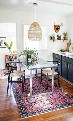 The light fixture over the table and the vintage Turkish rug guided the design for the entire space in terms of color and the materials.