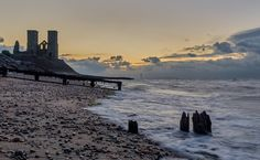 Reculver Towers. FuN FACt -  Where the tower stands is the middle of the fort. The land has been eroded by a good hundred metres since it was there. ////// #reculver #thanet #planetthanet #romans #fort #beach #sea #kent #uk #england #groynes #erosion #church #remains #towers #waves #sonya6000 #sigma #nisi #ndfilter #captureonepro #photoshop #longexposure #sunset #clouds #gold #sand @visitkent