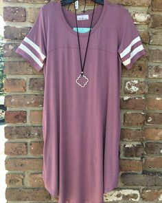 We have this trendy dress in several colors... purple pink blue green... come see what you can find today!! #shopoohlala #spring