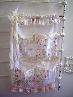 pocket organizer using vintage fabrics, lace and hankies.