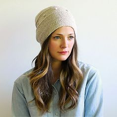 """This beanie with the perfect amount of slouch is fun and easy to knit. Snöflinga is the Swedish word for """"snowflake"""", which is the inspiration for this hat's details—its bobbles and patterned crown shaping are evocative of falling snow."""