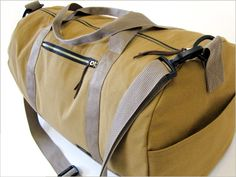 Safari Duffle in Canvas & Faux Leather | Sew4Home - would look epic in waxed navy cotton and leather straps!