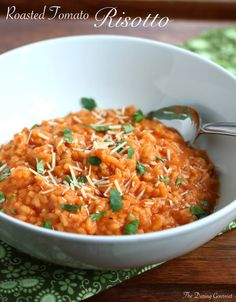 Roasted Tomato Risotto  --1 pound fresh whole tomatoes  --2 cloves garlic, peeled and halved --½ teaspoon sugar --2 tablespoons extra virgin olive oil --3 cups chicken or vegetable broth --1 small yellow onion, finely chopped --1 clove garlic, minced --1 tablespoon extra virgin olive oil --1 tablespoon butter --1 cup arborio rice --1½ teaspoons chopped fresh rosemary (or ¾ teaspoon dried) --¾ teaspoon salt --¼ teaspoon freshly ground black pepper --⅓ cup dry white wine
