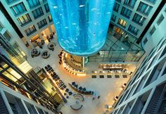 """AquaDom, Berlin, Germany - """"Watch trigger fish, mackerel, blowfish and other species swim around you as you make your way to the top of the AquaDom, which is located inside the Radisson Blu Hotel in Berlin-Mitte. The AquaDom is unique among world aquariums. The 82-foot-high acrylic cylinder, which teems with fish from all over the world, has a glass elevator inside it -- putting visitors right inside an aquarium as if they were fish themselves."""""""