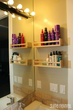 For bathrooms with limited counter and storage space - hang spice racks on a wall to hold all those bottles. This is an awesome idea..
