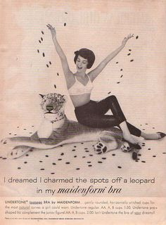 """""""I dreamed I charmed the spots off a leopard in my Maidenform bra""""    Maidenform """"I Dreamed..."""" ad  """"American Girl"""" magazine   May 1962 Issue"""