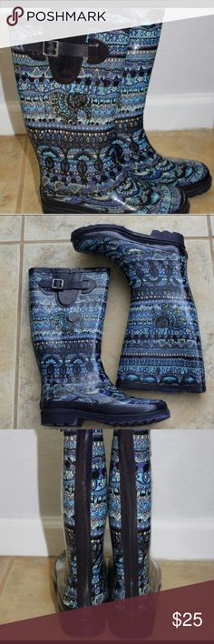 Excellent condition fuzzy lined rubber/rain boot Super cute worn a few times for very short intervals have elephants peace signs and fun patterns through out  super warm fuzzy lining inside and rubber waterproof outside make this a perfect fit for any fall/winter wardrobe Sakroots Shoes Winter & Rain Boots