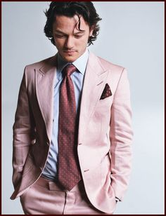 Luke Evans. Real men rock pink suits