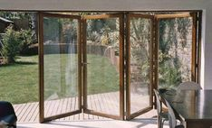 Timber bi folding doors - high security, long life, with safety glass