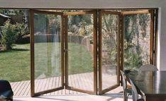 Wood frame bi-fold patio doors