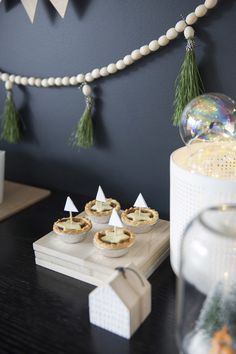 wooden beads with long pine needles painted gold. occasion wooden beads half painted maybe gold or light turgquoies...