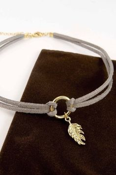 Gray double wrap choker with leaf is sure to inspire any outfit! #jewelrymakingtips #JewelryDIYIdeas
