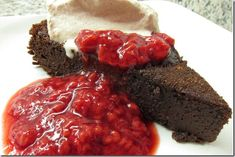 Flourless Chocolate Cake with Raspberry Sauce and Chocolate Whipped Cream (use can of coconut milk to whip)