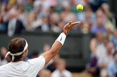 Rafael Nadal serves on Centre Court