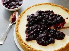 The Ultimate Cheesecake : Tyler Florence's cheesecake combines crushed graham crackers with just a touch of cinnamon for a warm, spicy note. The warm lemon-blueberry topping emphasizes the fresh lemon zest in the creamy cheesecake layer.