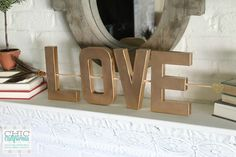 Use cardboard letters from the craft store, and X-ACTO knife, and spray paint to create easy and elegant DIY home decor.