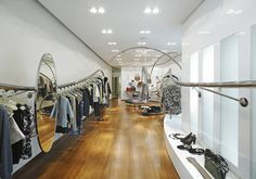 The stainless steel rails curve away the interior so customers flow through the store and browse the whole collection. Marni, Sydney, Australia.