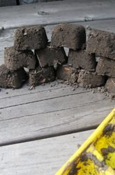 Here's an arts and crafts activity for preschoolers and pre-kindergarteners: build brick buildings with homemade mud bricks made from dirt and water.