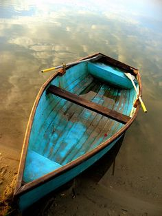 I like that the color of the boat is more evocative of the sky than the reflections of the clouds in the water. It's a nice bit of continuity.