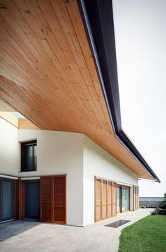 wood overhang... I see this on porches all the time and I love it.