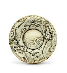 An Ivory Manju Netsuke | SIGNED HAKUHO, EDO PERIOD (19TH CENTURY) | Japanese Art Auction | mythological, netsuke | Christie's
