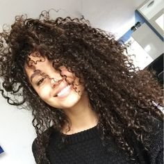This is really weirding me out because I keep coming across pictures of women who kind of look like me on Pinterest. My hair is darker and I have denser hair and some of my curls are tighter, but yeah, she could be my sister or me. [I actually went to ask 2 different people & they were just as astounded how much this girl looks like me][I sent it to my sister and she thought she looks like me & I sent it to my mom and she actually thought it was me! WTF! Really. Twin-person.]