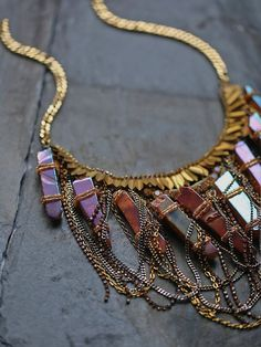Ashlyn Statement Crystal Necklace | Equal parts intricate and ornate, this bib necklace makes a major statement. Featuring beautiful raw crystals, sparking stone accents and tiered metal fringe for a uniquely layered design. Adjustable lobster clasp closure.