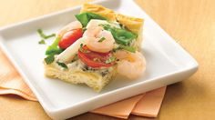 Spinach dip makes a sneaky time-saver in this veggie and seafood snack.