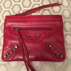 🛍 🎉HPBalenciaga Red Leather Mini Zip Pouch Pewter hardware.  Front zip pocket.  Main zip closure.  Interior zip pocket.  Measures: 7.75x6. Leather. Balenciaga Bags Clutches & Wristlets