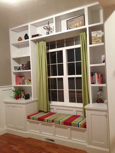 Built in bookshelves around the window with a seat for daydreaming for the front porch