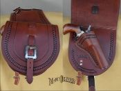 A unique and timeless way to carry your weapon on your horse. One side accommodates your pistol with a flap to conceal it and the other a full sized pocket to stow your gear. Leather Saddle Bags, Leather Holster, Leather Art, Custom Leather, Leather Tooling, Handmade Leather, Leather Jewelry, Revolver, Horse Gear