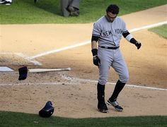ALCS GAME 4: Thursday, Oct. 18, 2012 - New York Yankees' Nick Swisher leaves home plate after striking out to end the third inning during Game 4 of the American League championship series against the Detroit Tigers in Detroit.