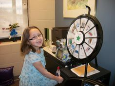 Students at Siegrist Elementary who have read 100 accelerated reader books are invited to Mrs. McClure's office to take a spin on the Prize Wheel or put a chip in the Plinko Game for a prize. Buy this Prize Wheel at http://PrizeWheel.com/products/tabletop-prize-wheels/mini-clicker-prize-wheel/