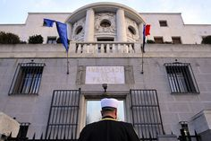 A representative of the Islamic community in Serbia observes a minute of silence in front of the French Embassy in Belgrade, Serbia.