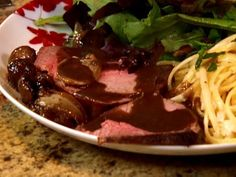 Drizzle tender roast beef with red-wine based gravy for the perfect weeknight meal.