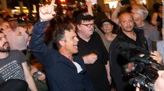 Filmmaker Michael Moore invited the audience at his one-man Broadway show to join him at a Trump Tower protest.