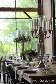 Some of the centerpieces will be silver candelabras with taper candles in glass hurricanes surrounded at the base by gold mercury glass votives.  www.stemfloral.com  I  www.savvy-images.com