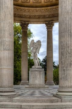 The Temple of Love was commissioned by Marie Antoinette to be part of her Hameau (place, often a rural area). It is made of marble and contains a dozen Corinthian columns that support the structure.  In the center is a statue of Cupid, (the Roman god of love, desire, and erotic love) fashioning his bow from the club of Hercules.  Marie Antoinette fancied the life of the peasants
