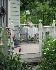 ♥ love the cottage feel - white fence with monarda and  daisies, birdhouse and trellis in the background.