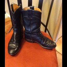 Navy Blue Justin Roper Boots  Pre-loved Justin Roper Boots. Still have a lot of wear. Just needs to be shoe shined. Navy blue. Says they are a size 6 but fit like a size 7. Justin Shoes