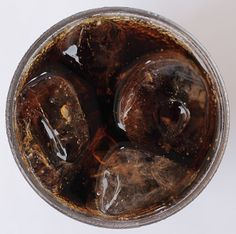 Coca Cola and Pepsi uses a chemical called 4-methylimidazole (pronounced methee-limi-dazzle), a known animal carcinogen  in their colas to give it the brown color. It's made by heating sugar with ammonia and sulphites at high temperatures which produces an industrial chemical.