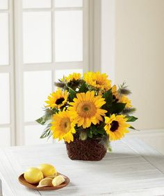 Sunflowers and mini sunflowers are the stars of this flower arrangement showcasing both yellow and brown centers to add interest and texture. Unique Flower Arrangements, Unique Flowers, All Flowers, Summer Flowers, Fresh Flowers, Online Florist, Local Florist, Mini Sunflowers, Rustic Baskets
