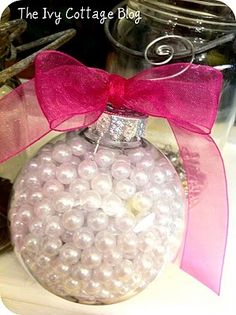 clear ornament with pearls and a girly ribbon