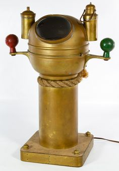 Lot 165: Brass Ship Binnacle by Sestrel; c.1920, having interior compass, iron green and red handles and wood base