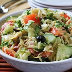 Orzo pasta is tossed with artichoke hearts, cucumber, feta, tomato, olives and a zesty dressing.