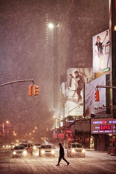 NYC. Wall characters warm the cold, snowy scene. // Christophe Jacrot