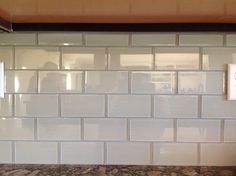 Loft Cream Polished Gl Tiles Provide A Nice Simple Contrast To The Cupboards And Granite Counter