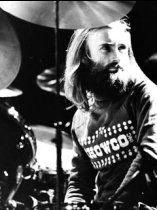 Phil Collins, drummer and singer with British rock band Genesis, takes a break behind his drumkit.